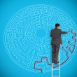 Businessman drawing red line to solve a complex maze — Stock Photo