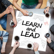 Learn and lead written on a poster with drawings of charts — Stock Photo