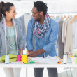 Smiling fashion designers working together — Stock Photo