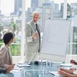 Serious businessman giving a presentation — Stock Photo
