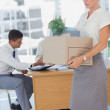 Businesswoman holding a box and his colleagues in the bottom — Stock Photo #26991465