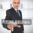 Stock Photo: Businessman touching the term personal development