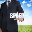 Businessman selecting speed word — Stock Photo