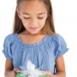 Cute little girl holding a wrapped gift — Stock Photo