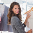 Stock Photo: Fashion woman choosing clothes