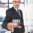 Stock Photo: Businessmselecting word cost
