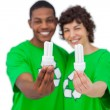 Stock Photo: Cheerful activists holding energy saving light bulbs
