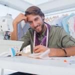 Happy designer working at his desk — Stock Photo #26994095