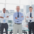 Team of smiling business standing with arms folded — Stock Photo #26994211