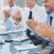 Group of business clapping together — Stock Photo