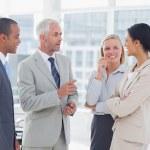 Happy business team talking — Stock Photo