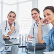 Three smiling women doctors — Stock Photo