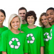 Group of smiling activists wearing green shirt with recycling sy — ストック写真