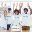 Volunteers raising their arms  — Stock Photo