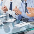 Group of business applauding in the boardroom — Stockfoto