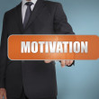 Businessman selecting the word motivation written on orange tag — Стоковая фотография