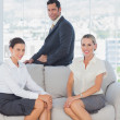 Business sitting on the couch — Stock Photo