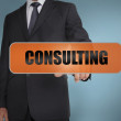 Stock Photo: Businessmtouching word consulting