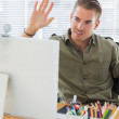 Stock Photo: Creative business employee waving in modern office