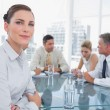 Serious businesswoman in a meeting — Stock Photo