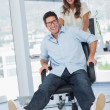 Stock Photo: Happy designers having fun with swivel chair