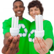 Stock Photo: Environmental activists showing energy saving light bulbs