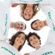 Low angle view of a smiling group of volunteers — Stock Photo
