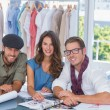 Three fashion designers smiling — Stock Photo