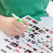 Photo editor marking contact photographs — Stock Photo
