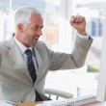 Businessman cheering — Stock Photo