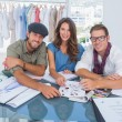 Smiling fashion designers smiling at camera — Stock Photo
