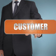 Businessmselecting word customer written on orange tag — Stock Photo #26997093