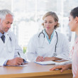Two doctors with a female patient — Stock Photo