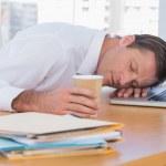Businessman sleeping on a laptop — Stock Photo #26997243