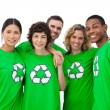Stock Photo: Group of wearing green shirt with recycling symbol on it