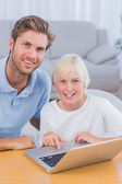 Father using laptop with his son — Stock Photo
