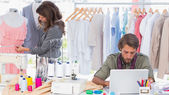Fashion designers working in a bright office — Stock Photo