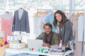 Two fashion designers looking at camera — Stock Photo