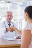 Patient shaking hands to doctor — Stok fotoğraf