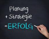 Hombre escribiendo erfolg y estrategia planung — Foto de Stock
