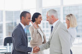 Succesful business team shaking hands and high fiving — Stock Photo