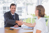Smiling businessman shaking hand of a job applicant — Stock Photo