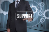Businessman selecting a label with support on it — Stock Photo