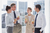 Group of cheerful business clinking their flutes of champagne — Stock Photo