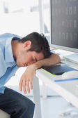 Graphic designer sleeping on his keyboard — Stock Photo
