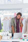 Fashion designer on the phone — Stock Photo