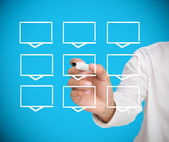 Businessman drawing a grid of white rectangles — Stock Photo