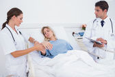 Doctor taking heartbeat of a patient — Stock Photo