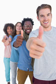 Cheerful in row with thumbs up — Stock Photo