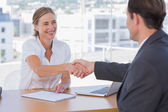 Cheerful interviewer shaking hand of an interviewee — Stock Photo